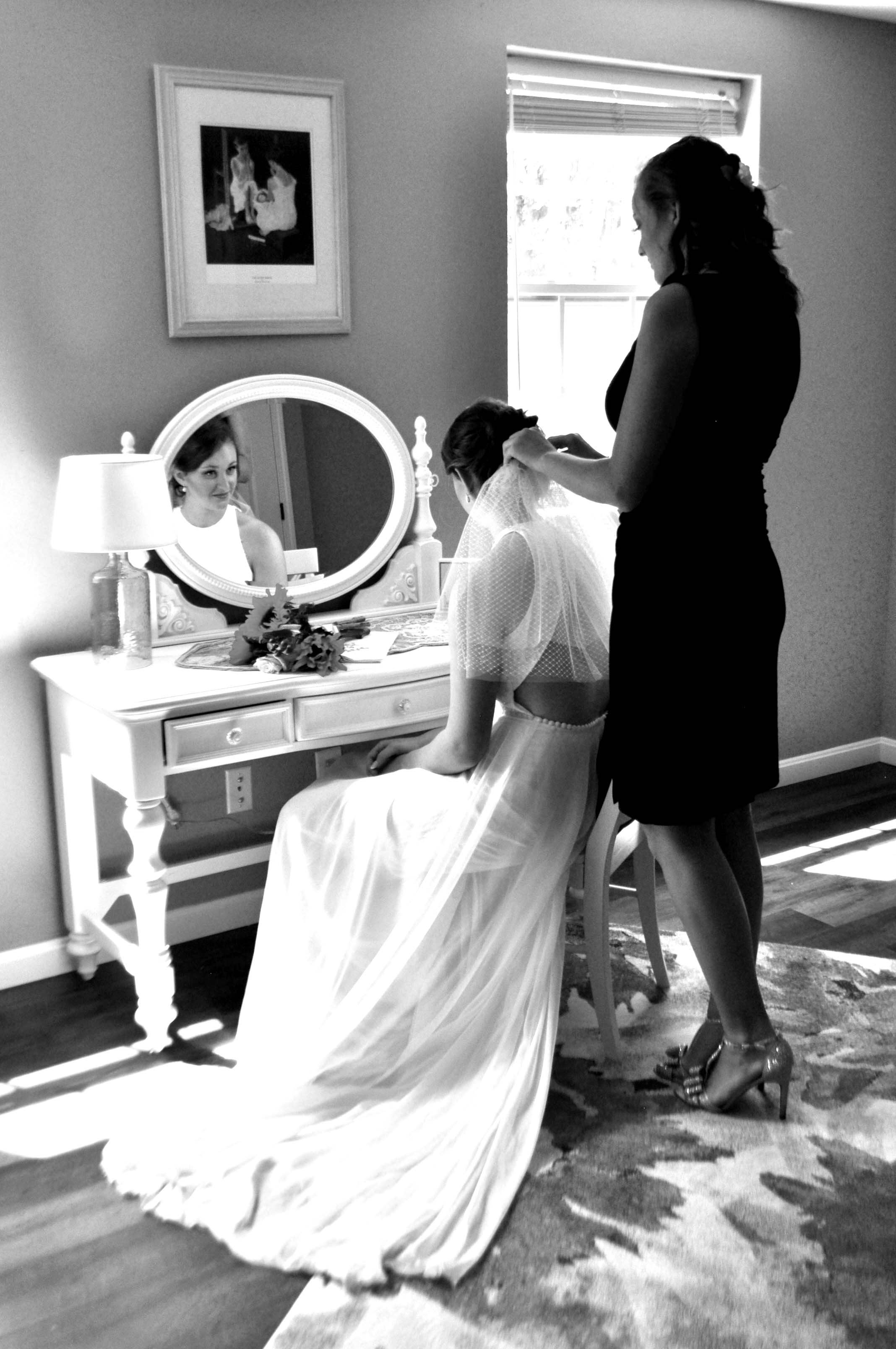 Bride getting ready in bridal staging room