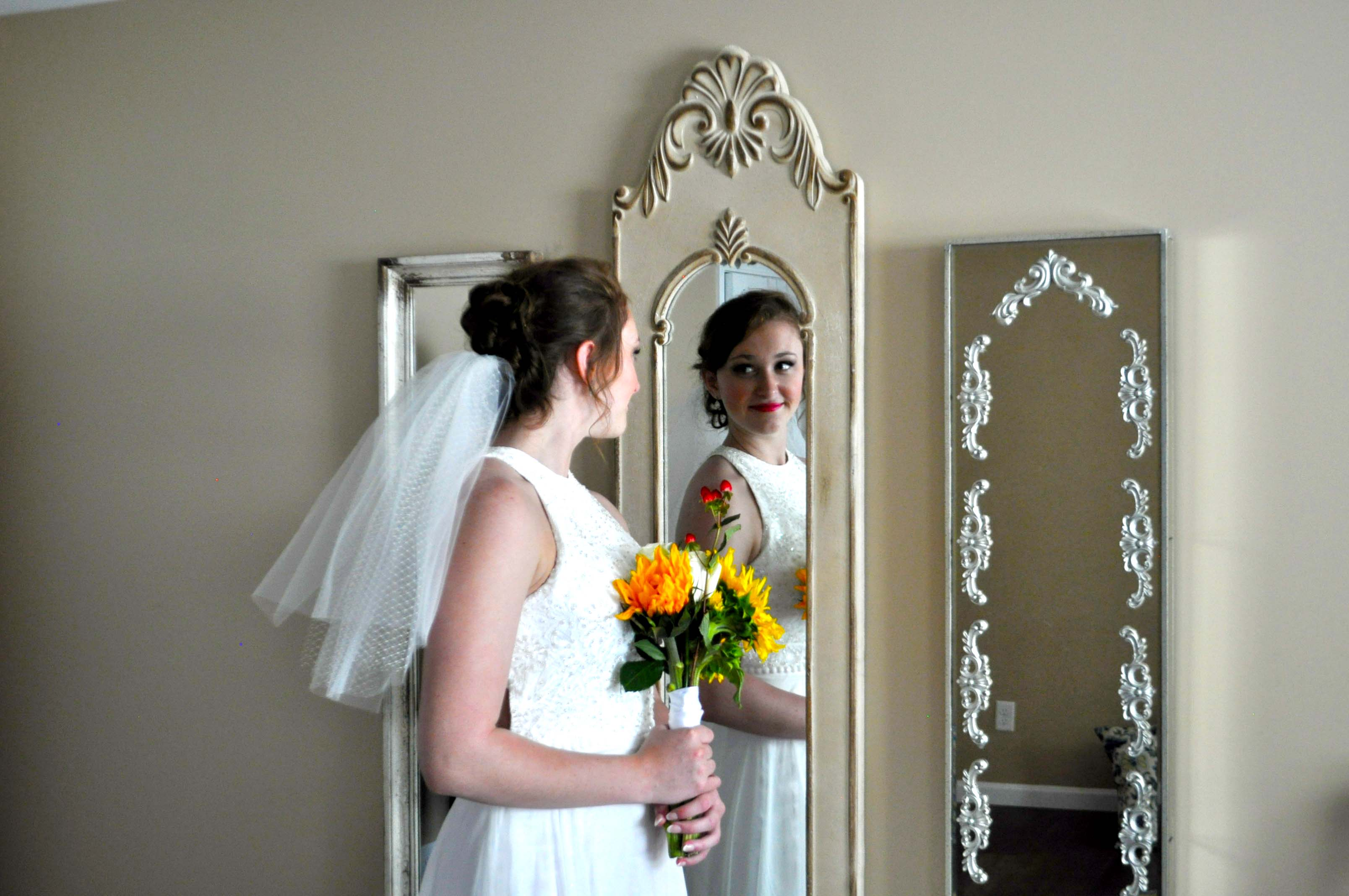 Bride in front of stating room mirrors