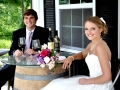 Bride and Groom sitting on tasting room porch
